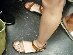 Candid feet train ride