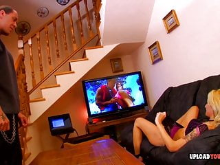 Porno video: Wife watches TV while being penetrated hard