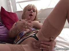 Mature British blonde takes on FAT vibrator