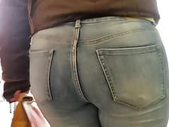 Hot and sexy big round ass in tight blue jeans