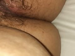 Wife making a mess in her hairy cunt.