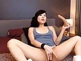 Nikki uses a dildo