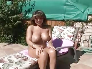 Matures Brunettes Big Tits video: Busty brunette milf blows the pool boy