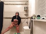 Masturbating with shower head and small broom
