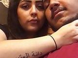 arabian couple kissing in public