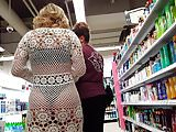 Candid voyeur girl in bikini with see thru wrap shopping