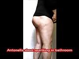 Antonella short spanking in public bathroom