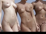 Four beach babes in bikinis getting naked on the beach