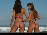 Two hot beach babes in micro bikini getting naked