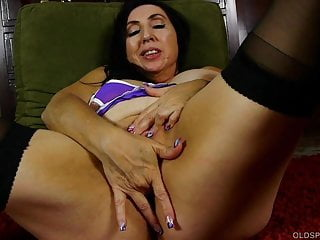 Awesome older babe in hot lingerie fucks her juicy fat pussy