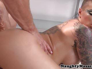 Beautiful inked babe cocksucking masseuse
