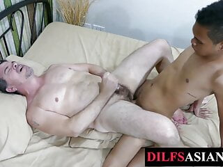 Mature daddy barebacked by asian twink after licking feet