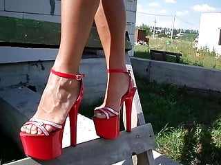 Under the dress, red thong on the stairs with high heels.