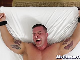 Bound mature hunk laughs while he receives tickling torment