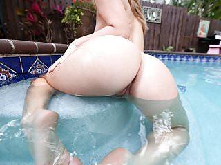 Eva lovia takes by the pool...