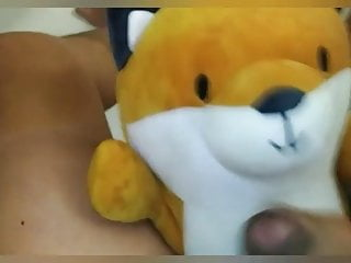 Pissing and jacking off on plushie fox...