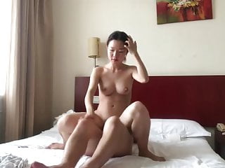 Chinese Couple In A Hotel Room