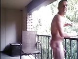 horny dad stroking on his balcony for everyone to see