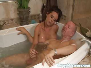 Bigtitted WAM masseuse wanks cock till cum
