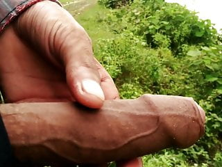 Outdoor masturbation in the road side and cumshot on tree