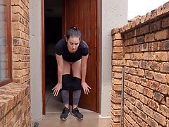 Woman pissing out of the front door