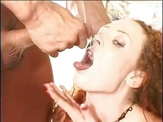 Redhead gets cum in her mouth and shares it with other girl