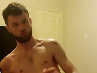 bearded beauty wanks and cums on his bed