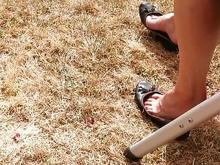 candid shoeplay in worn flats