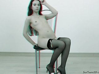 Teen posing and spreading her legs on a armchair