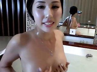 Asian girl has fun bath...