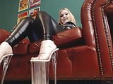 Smoking babe In Latex wearing 10 inch Clear Platforms Heels