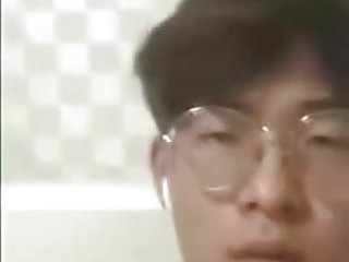 Korean boy with glasses cum frontal to camera...