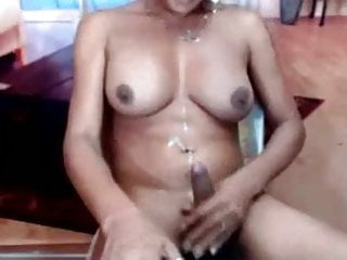 Shemale jerks cums and cleans up...