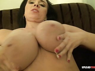 Busty chick gets her tits massaged while oiled...