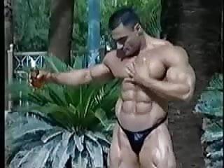 Bodybuilder oiling himself...