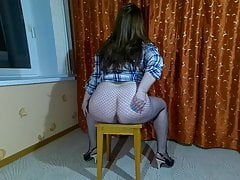 Posing on a chair with my back to the camera (part 2)
