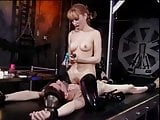 Mistress fools around with her slave bound to the rack