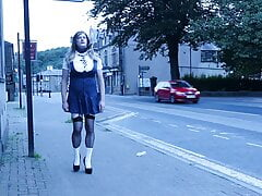 crossdressed in uniform outdoors on a main road