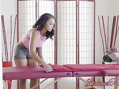 Stunning ebony masseuse works on her clients back and pussy