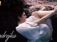 Aqua girl Andrejka underwater stripping and swimming