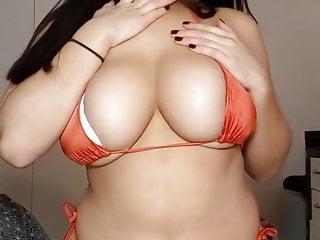 Bikini boob rub...
