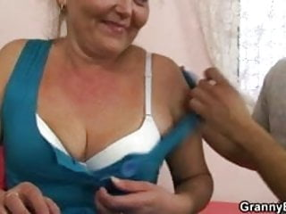 Flabby oldie spreads her legs