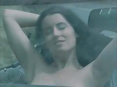 Beauty girl undress in a car trip