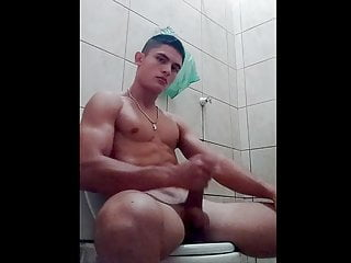 fit mexican boy in the restroom