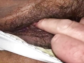 Playing with her hairy pussy through her panties