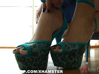 Asian striptease and foot play...