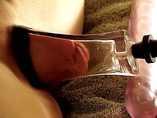 pumped pussy lips in a tight, flat glass tube