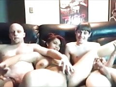 Threesome play on couch