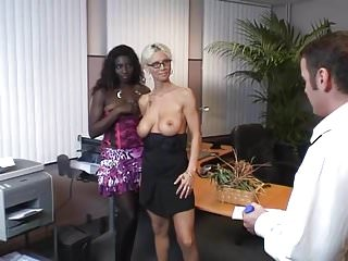 Blond and black girl office...