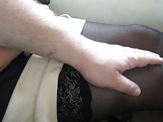 Touching her legs in stockings in a train